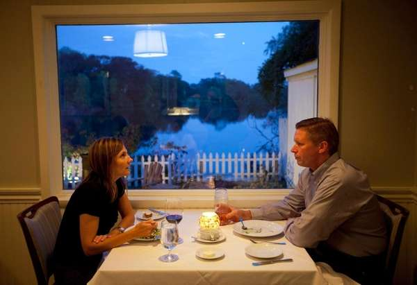 Diners share a romantic meal at The Lake
