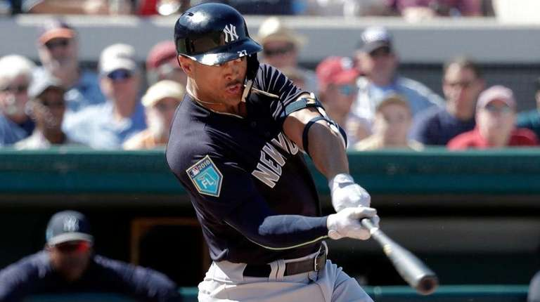 The Yankees' Giancarlo Stanton hits a double in