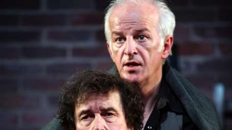 Stephen Rea carries Sean McGinley on his back