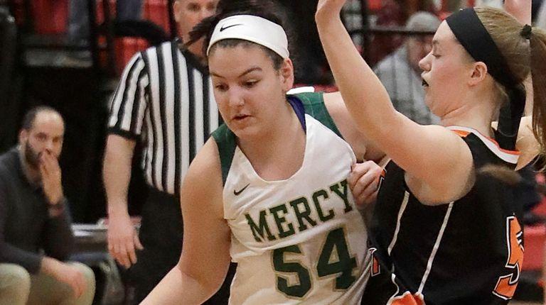 Mercy's Gianna Santacroce drives against East Rockaway's Rachel