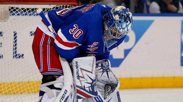 Henrik Lundqvist of the Rangers looks on during