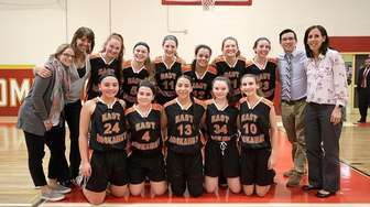 The East Rockaway girls basketball team poses after