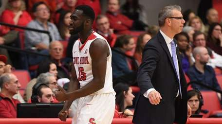 Stony Brook guard Akwasi Yeboah walks to the