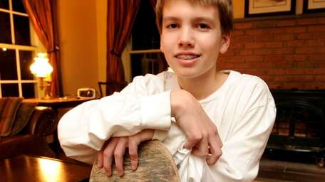 Wes Ackley, 14, poses with his skateboard. (Jan.