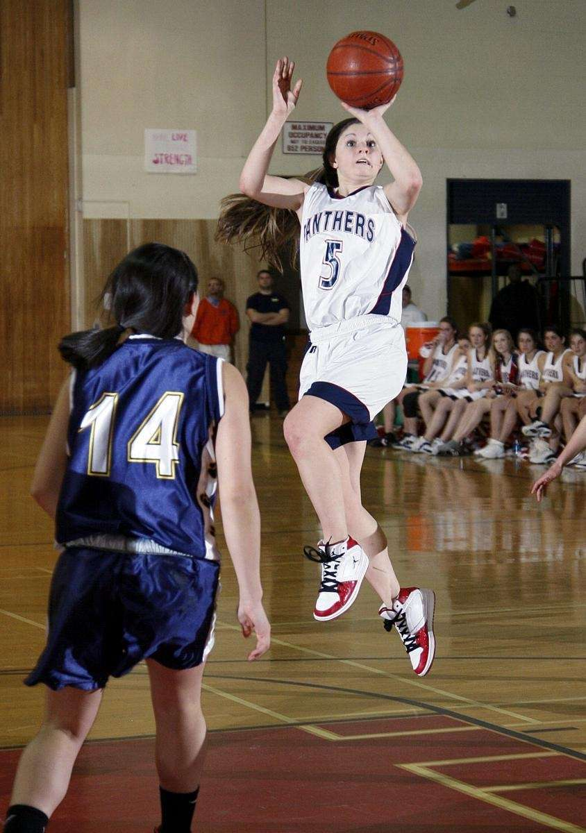 Miller Place's Deanna Molinelli (5) flies through the
