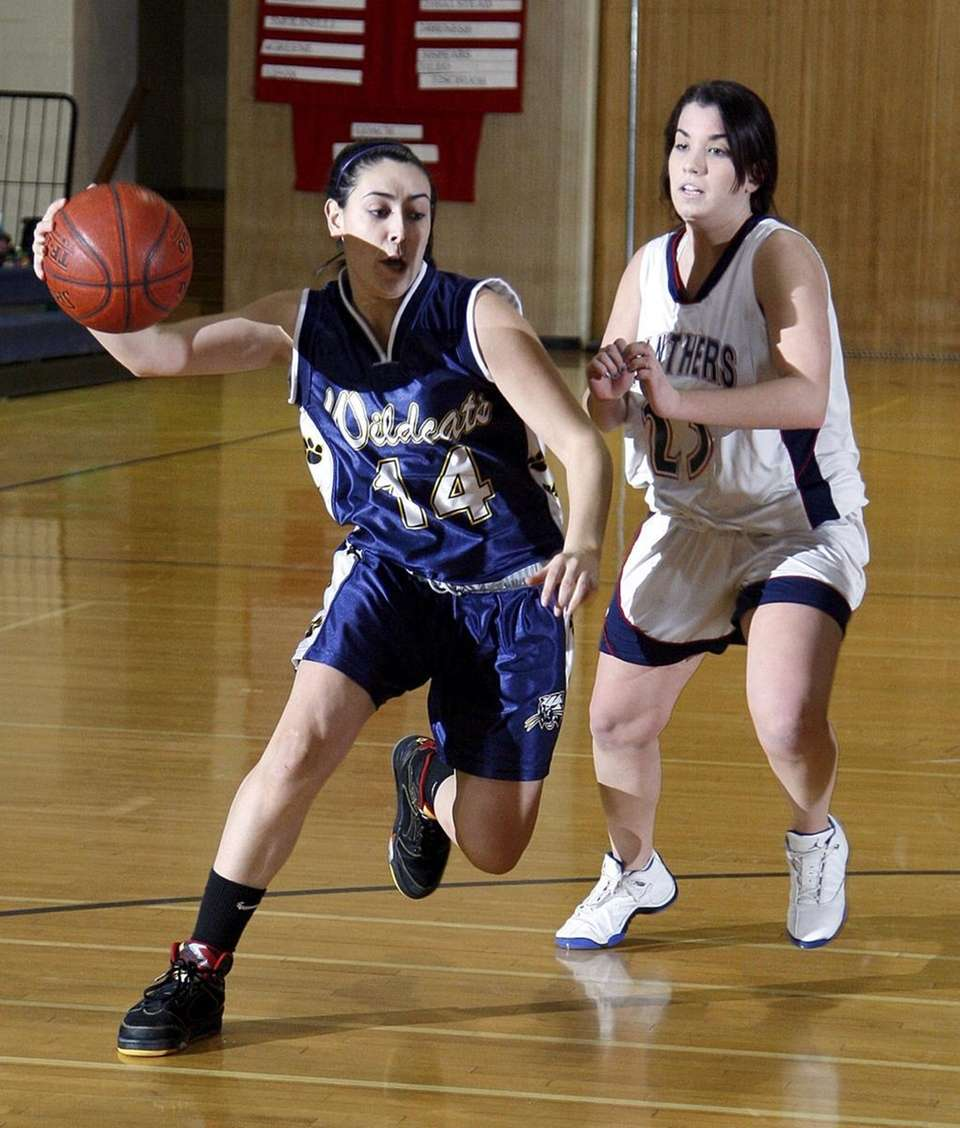 Shoreham's Samantha Villafranca drives against Miller Place's Dana