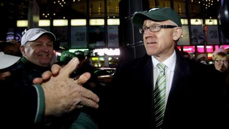 New York Jets owner Woody Johnson, right, greets