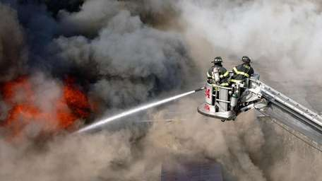 Members of the FDNY fight a six-alarm fire