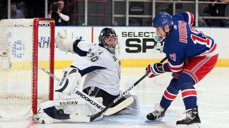 Rangers center Brandon Dubinsky tries to beat Tampa
