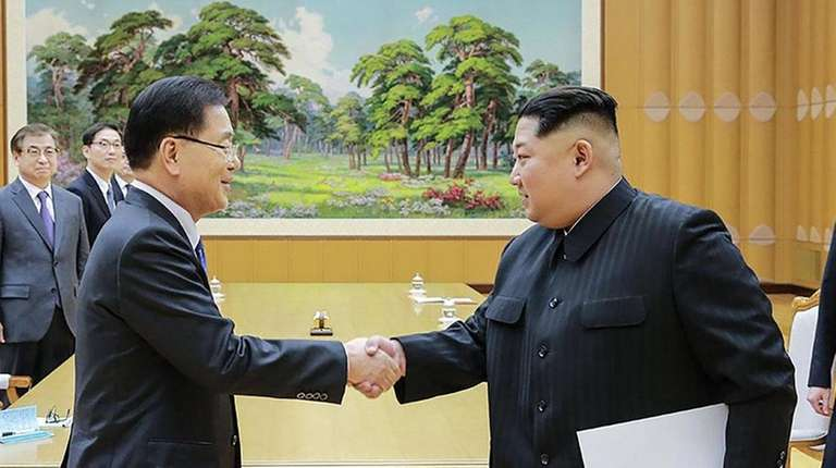 South Korean chief delegator Chung Eui-yong shakes hands