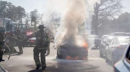 Riverhead police and firefighters responded to car on