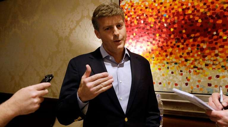 Yankees owner Hal Steinbrenner talks with reporters following