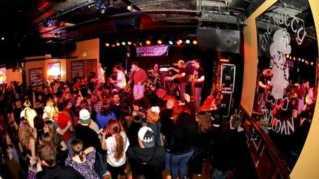 A band performs for a packed house at