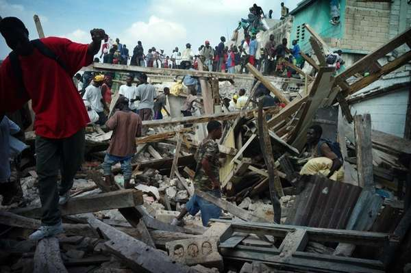 Looters take everything they can in the rubble