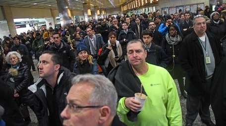 LIRR riders wait at Penn Station during the