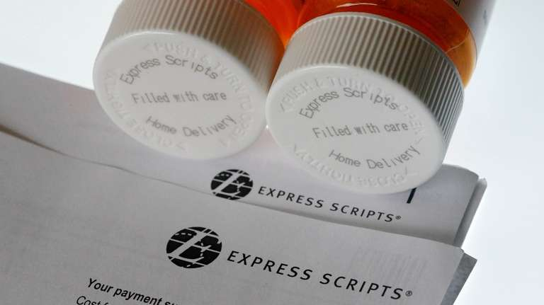 Express Scripts prescription medication bottles are arranged for