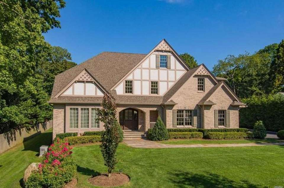 This Cold Spring Harbor Tudor has four bedrooms