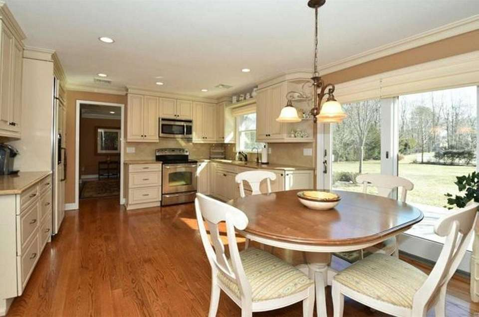 The eat-in kitchen in this Smithtown ranch includes