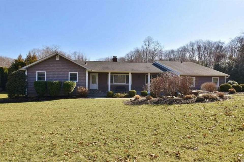 This Smithtown ranch includes three bedrooms and three