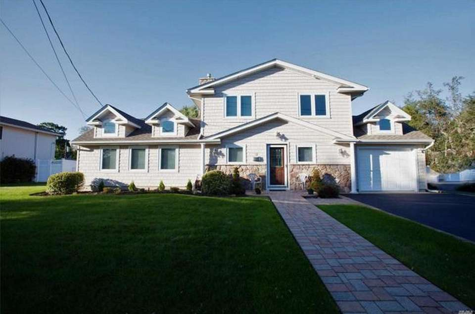 This Old Bethpage Colonial includes four bedrooms and