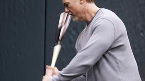St. Louis Cardinals batting coach Mark McGwire swings