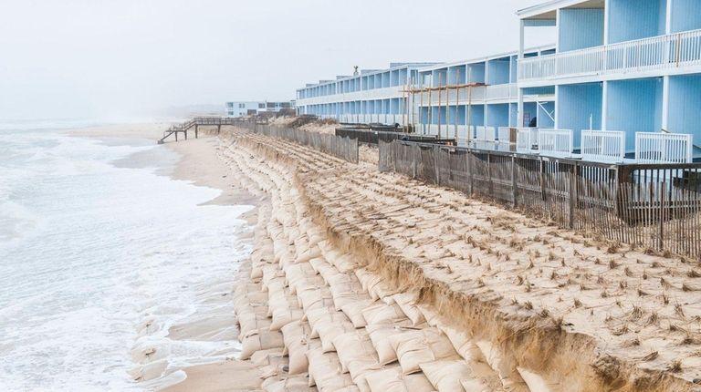 Erosion along an artificial dune made from sandbags