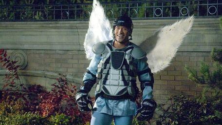 Hockey player-turned tooth fairy Derek Thompson (Dwayne Johnson)