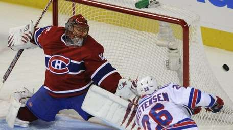 Montreal Canadiens goaltender Jaroslav Halak, top, makes a