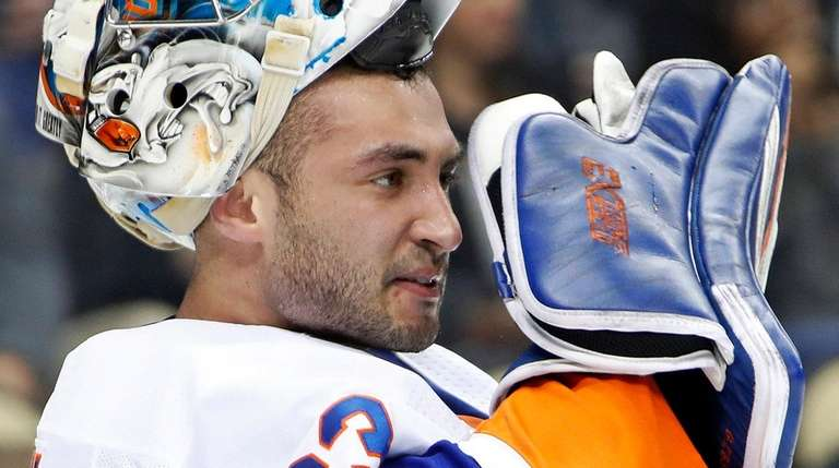 Islanders goaltender Christopher Gibson pauses after allowing a