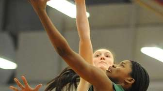 Zhaneia Thybulle of Elmont scores the opening basket