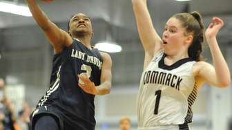 Aziah Hudson of Baldwin, left, drives to the