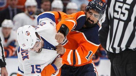 The Islanders' Cal Clutterbuck and the Oilers' Jujhar