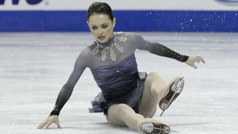 Sasha Cohen falls as she performs her routine