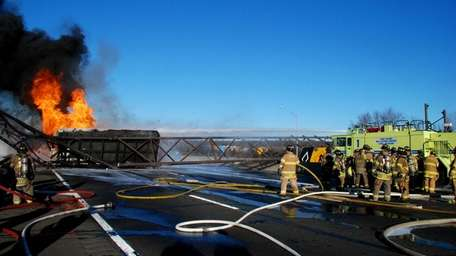A fuel tanker clipped a sedan, flipped and