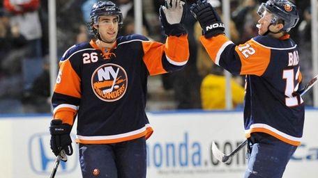 New York Islanders' Matt Moulson (26) is congratulated