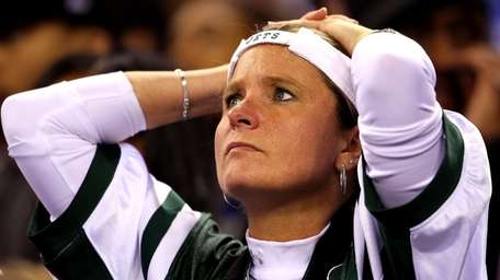 A Jets fan reacts in the fourth quarter