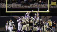 New Orleans Saints kicker Garrett Hartley (5) kicks