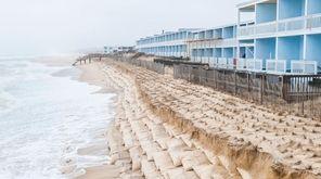 Erosion along a sandbag dune in front of