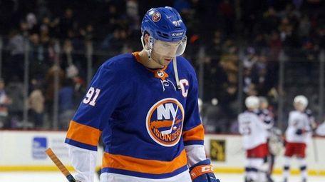 Islanders center John Tavaresleaves the ice after losing