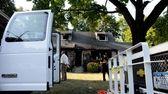 Police investigate the scene of a triple homicide