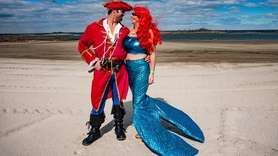 Pirate John Richy, 36, of Northport, with mermaid