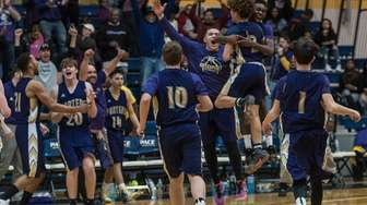 Greenport players celebrate their win in the state