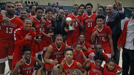 Amityville celebrates their victory in the Long Island