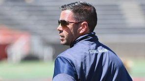 Stony Brook head coach Joe Spallina looks on