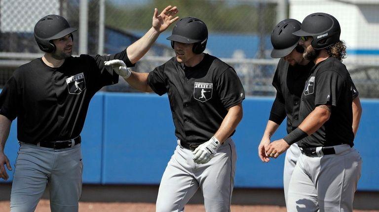 Major League Baseball free agent Tyler Moore, center,