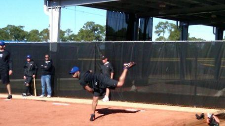 Johan Santana throws off a mound for the