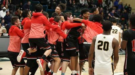 Half Hollow Hills East players react after defeating
