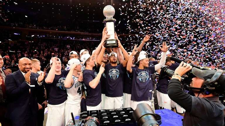 The Villanova Wildcats hold up the trophy after