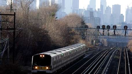 An LIRR train navigates down the tracks in