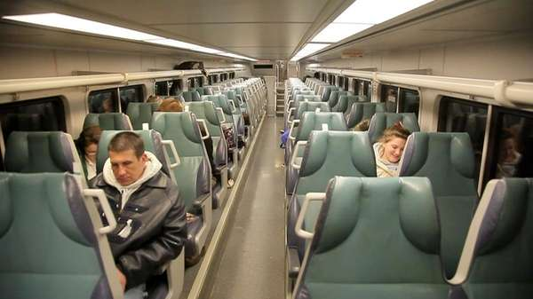Passengers ride the early morning train from Greenport